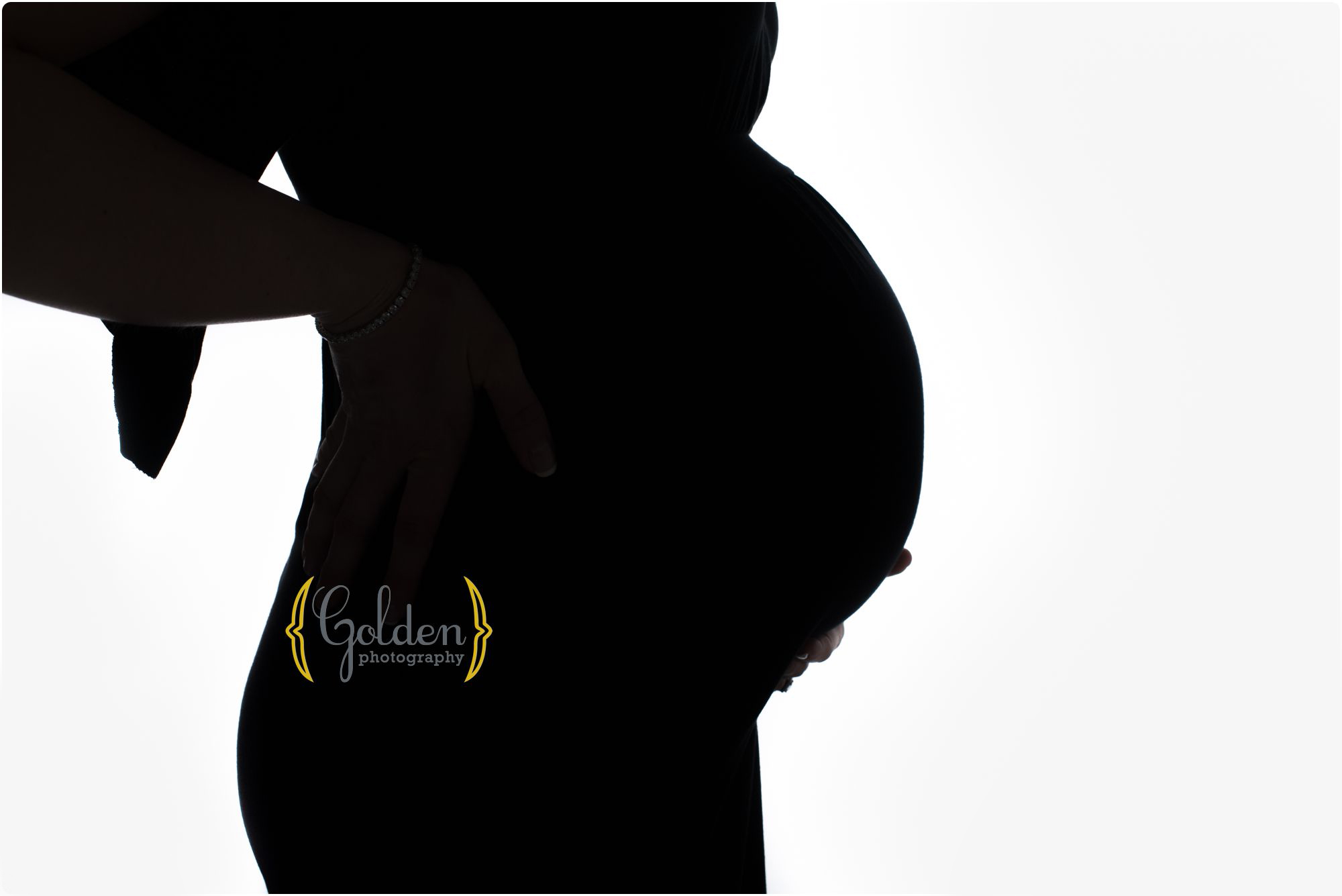 silhouette of pregnant belly on white background in Lake County IL photo studio