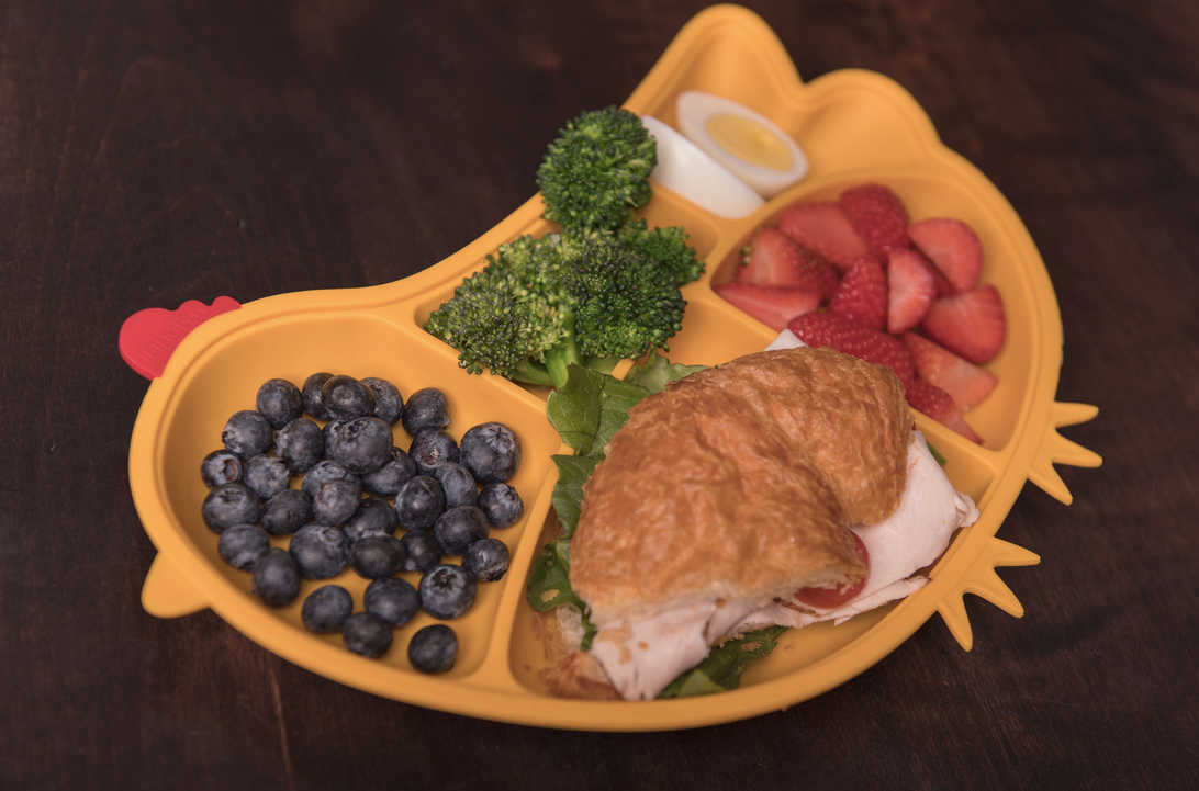 chicken shaped child tray in home