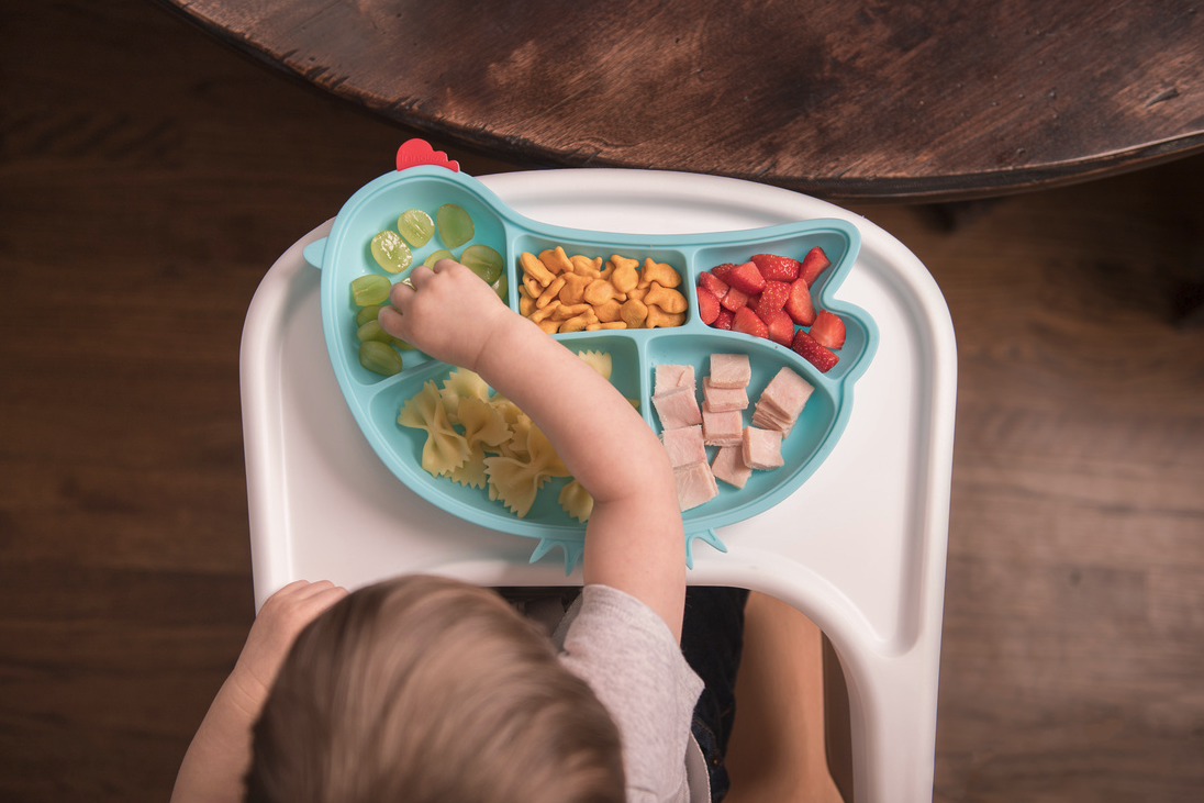 child eating food on tray in Barrington IL